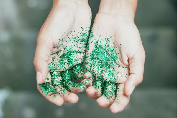 Hands with green glitter